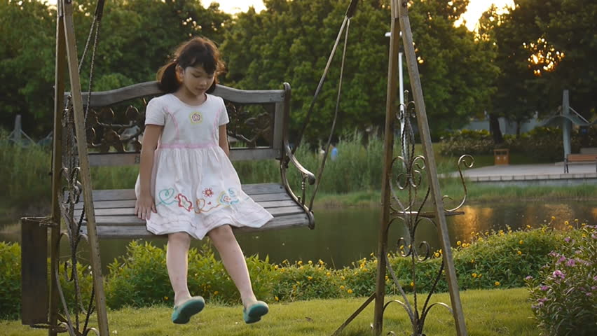 Asian kid swinging in the park - HD stock footage clip