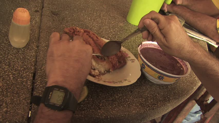AMAZON REGION, BRAZIL - CIRCA 2010:  People eating local indigenous food made from acai berries - HD stock video clip