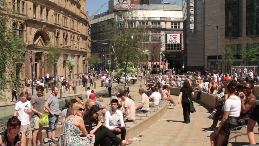 MANCHESTER, LANCASHIRE/ENGLAND - MAY 25: Unidentified shoppers enjoy Spring sunshine in Exchange Square on May 25, 2012 in Manchester. Exchange Square was redeveloped after IRA bombing in 1996