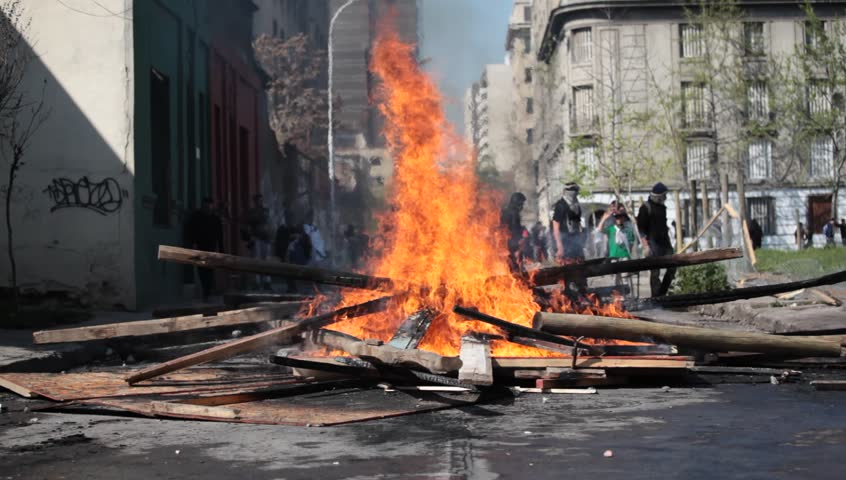 Street Fire. Street damage caused during a student strike on September 22, 2011 in Santiago, Chile. Protesters demand the government to improve education quality. - HD stock footage clip