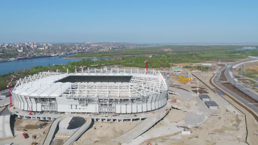 Aerial view on construction and reconstruction of football stadium. Reconstruction of stadium to host matches of world football championship in 2018. Russia. Construction company builds a stadium