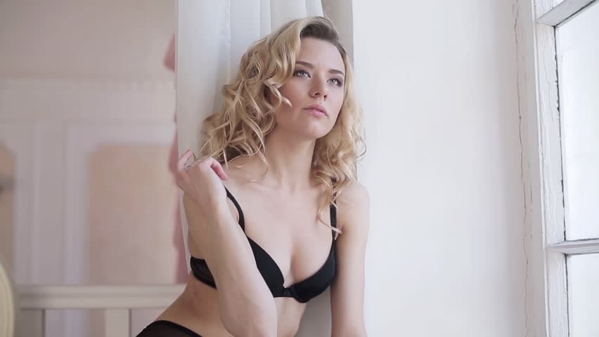 Female portrait of cute lady in black bra indoors. Close up beautiful sexy model girl in elegant pose. Closeup beauty blonde woman with hairstyle | Shutterstock HD Video #26659645