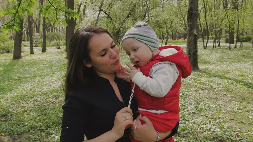 Mom walks with the child on a beautiful sunny day   Shutterstock HD Video #26746927