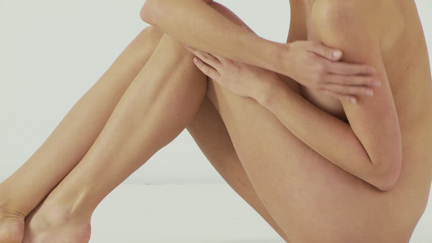 Woman sitting and rubbing legs - HD stock footage clip