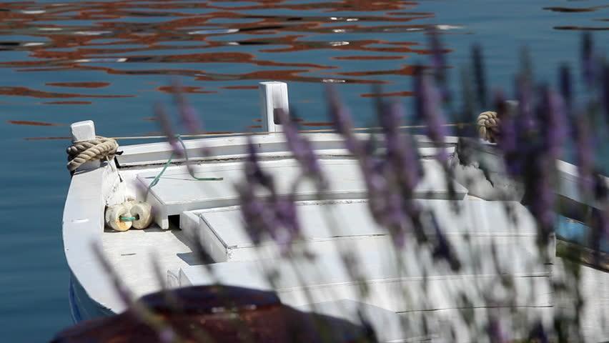 Sea boat and lavander  Description: Fishing boat, sea, lavander and a bee.    - HD stock footage clip