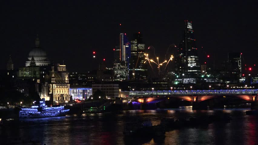 4K Beautiful firework explosion in London, city panorama with modern skyscraper emblem