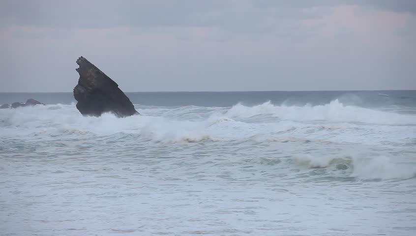 Stormy waves beside the rocky cliff. Atlantic ocean coastline, Portugal | Shutterstock HD Video #26992042