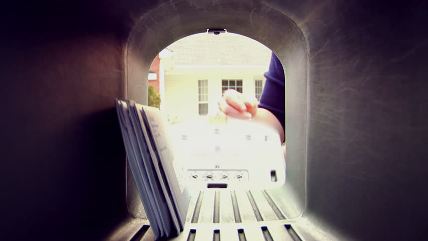 A POV shot of someone taking letters and mail out of the mailbox 1080 HD video