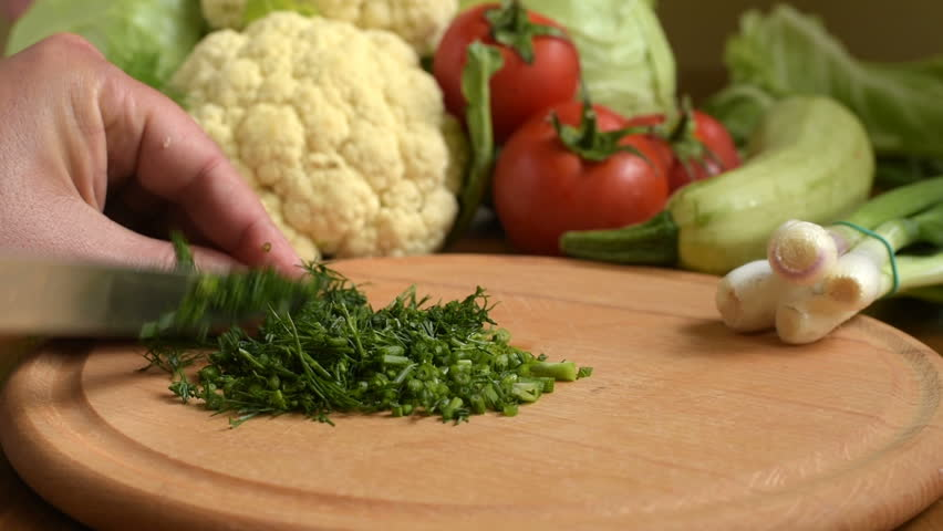 Cooking. Cutting fresh  dill. Cutting fresh vegetables.  Slicing dill on a chopping board. chopping salad. vegetables background. Chopping Vegetables Full HD1080p. The concept of healthy lifestyle  #27187522