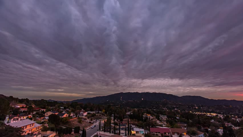 Los Angeles, California. Rolling clouds over a night-time, suburban neighborhood.  | Shutterstock HD Video #27191779