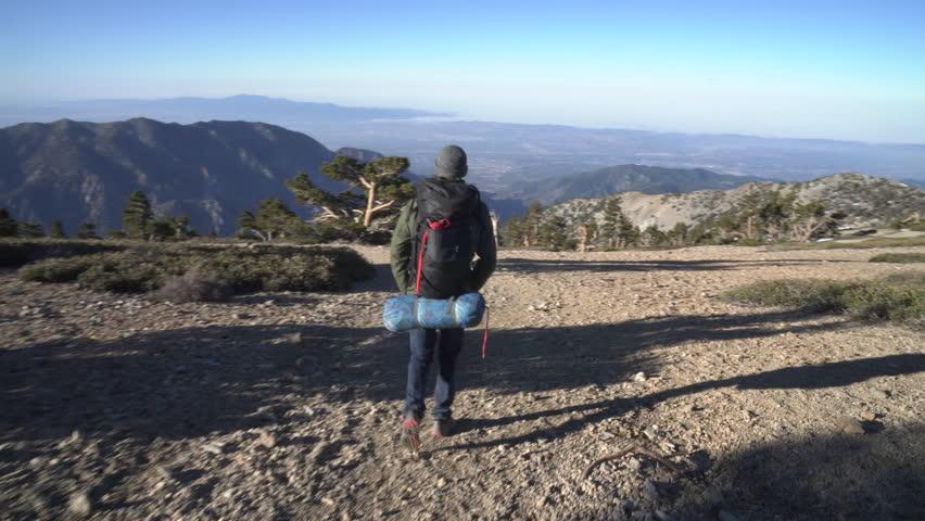 Hiker on a trail alone in the wilderness | Shutterstock HD Video #27193750