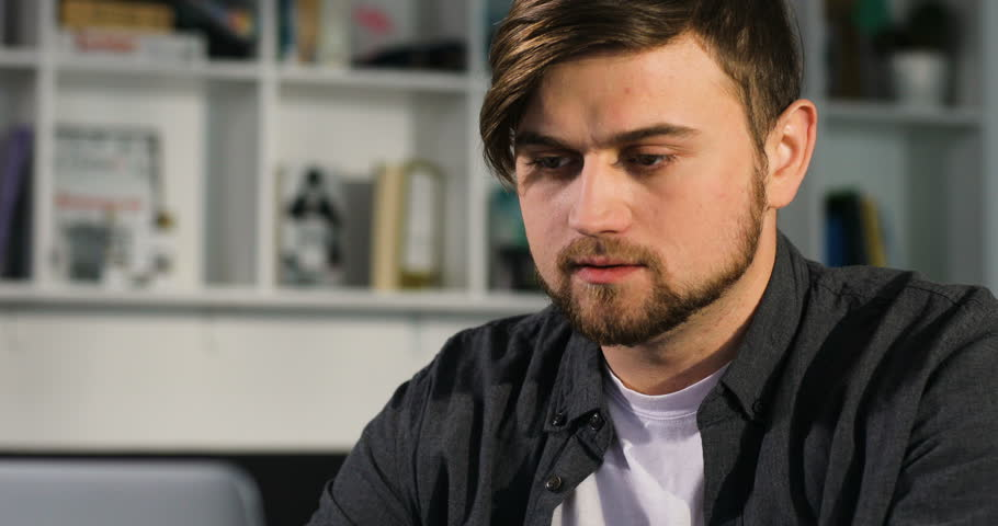 Portrait of young attractive man uses a laptop in the office | Shutterstock HD Video #27205360