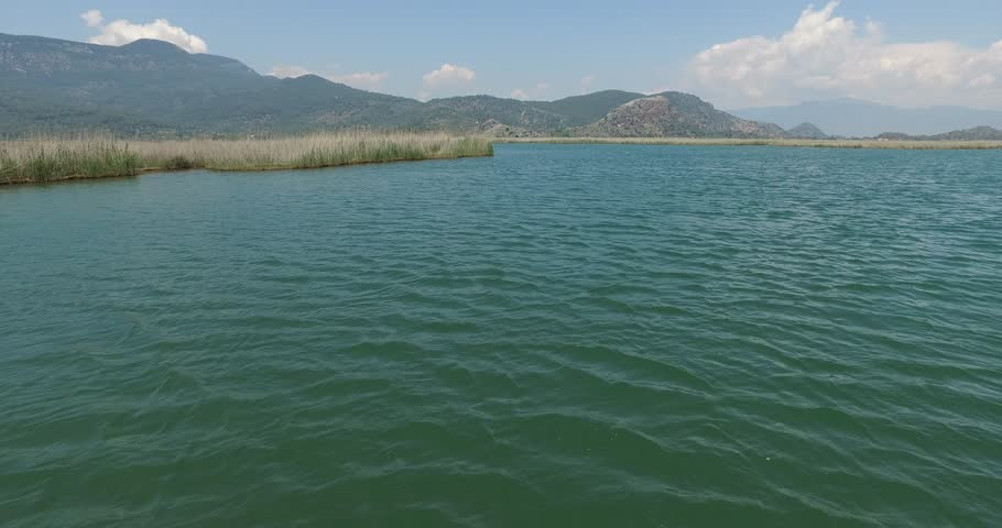 The Dalyan River with tourist boats in the straits of the river  | Shutterstock HD Video #27390373