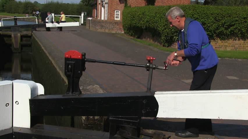 STAFFORDSHIRE & WORCESTERSHIRE CANAL -  AUGUST 6, 2012: A lock gate being operated - HD stock footage clip