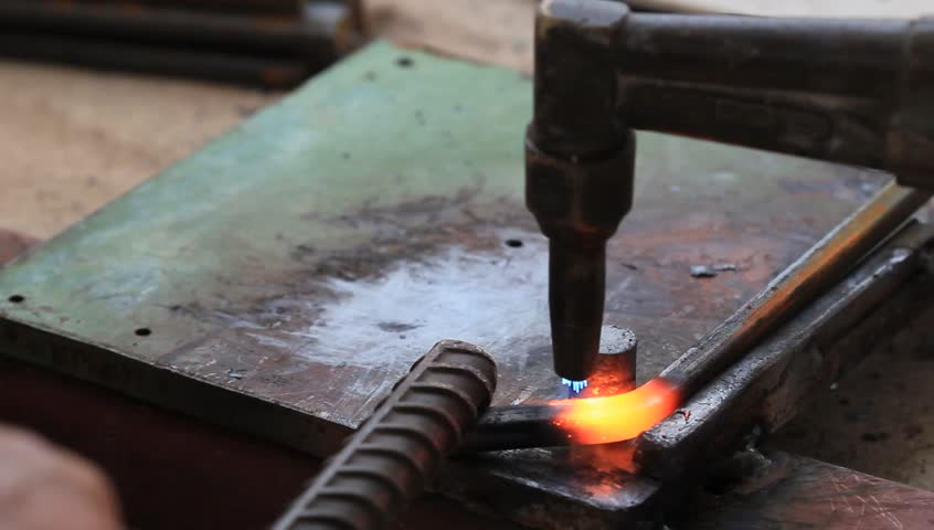 Gas heating cutting metal using torch and bending square bar, industrial construction clip. - HD stock footage clip