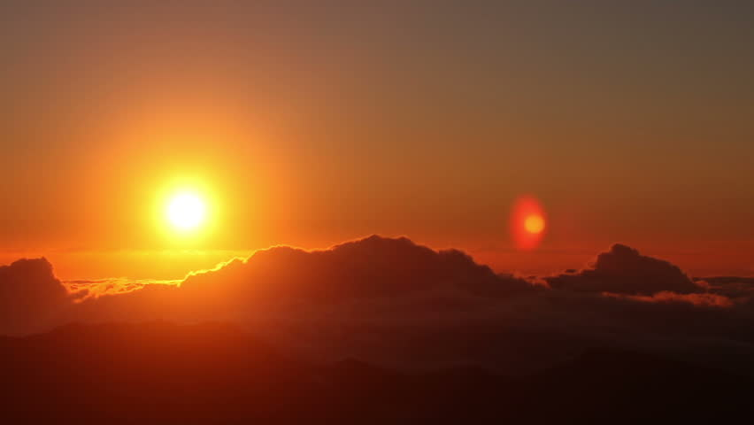 Brilliant summit dawn above flowing cloud waves, red sun disk time lapse in HDR  #2786668