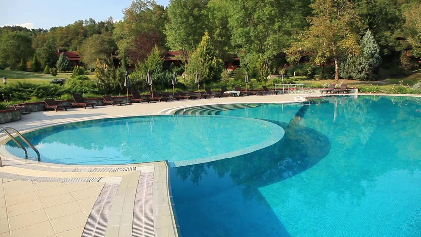 luxury village and pool, pan shoot - HD stock footage clip