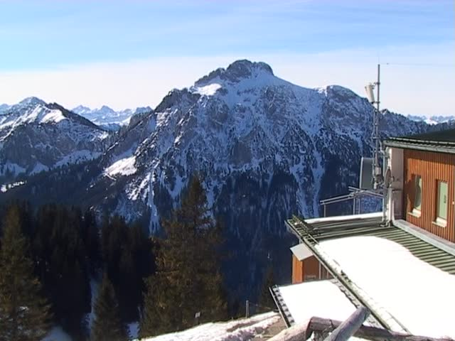 Panorama view from the Tegelberg on the northern ridge of the German Alps, looking over the mail Alps regions of Tirol, Austria. - SD stock footage clip
