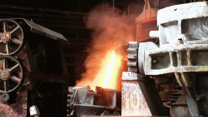 Metallurgy / Closing the melting furnace... - HD stock footage clip