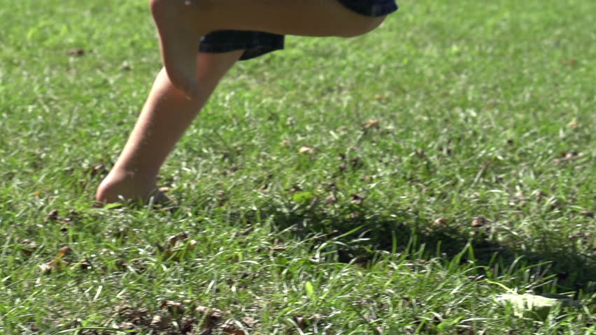Boy running by in grass slow motion | Shutterstock HD Video #2816053