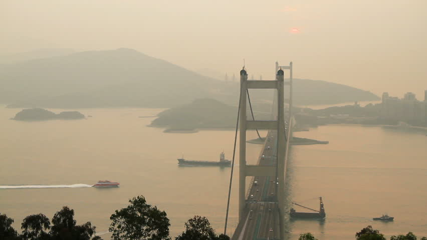 Tsing Ma Bridge and  ship at Sunset - Tsing Ma Bridge is a bridge in Hong Kong.