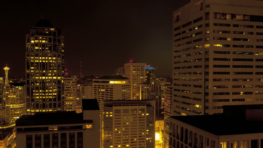 Time lapse of the shadow moving through Skyscrapers in Seattle during dawn and