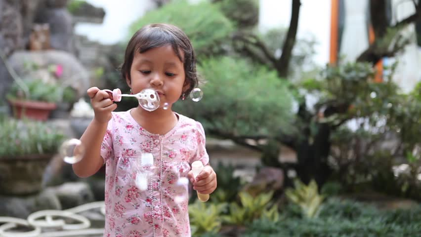 Cute little girl having fun with bubbles - HD stock footage clip