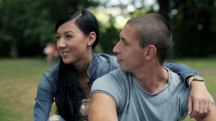 Happy teenage couple in love in the park, steadicam shot  - HD stock video clip