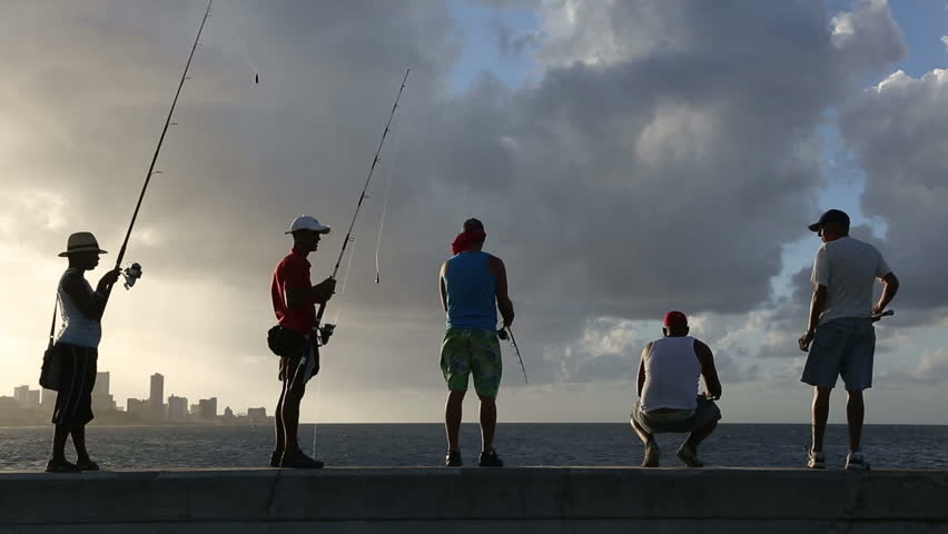 Cuba, Havana, 2016, Cuban fishing in the evening along the promenade Malecon, EDITORIAL | Shutterstock HD Video #28252015