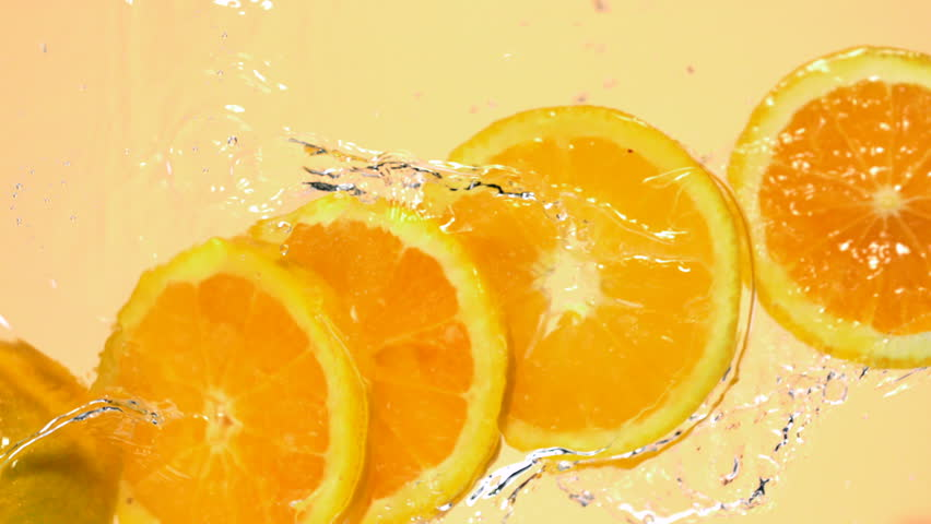 Sliced orange in water shooting with high speed camera, phantom flex.