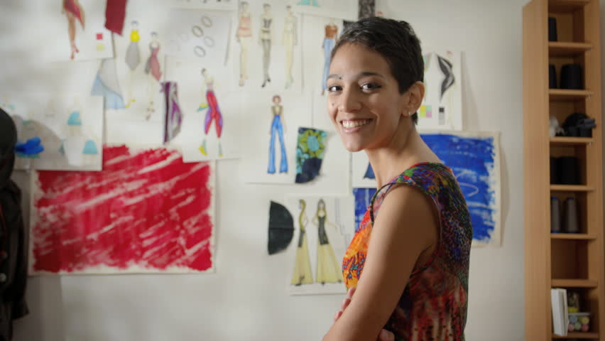 Confident entrepreneur, portrait of happy hispanic young woman working as fashion designer and dressmaker in atelier | Shutterstock HD Video #2827600