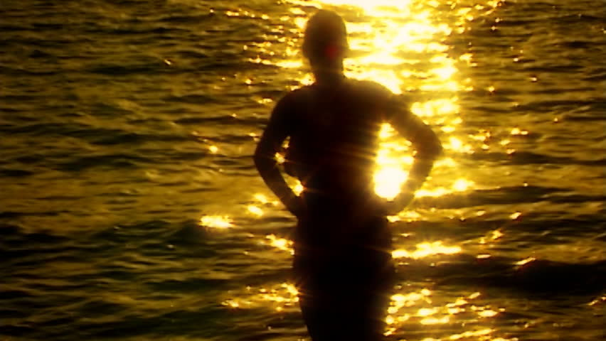 shilouette nude reflecting water  in slow motion - slightly soft - HD stock footage clip