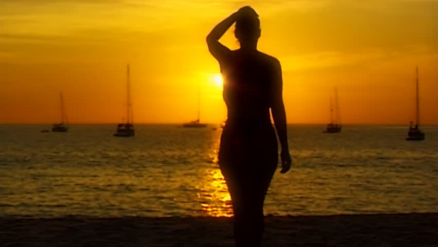 topless woman beach sundown 01soft in slow motion - slightly soft - HD stock footage clip