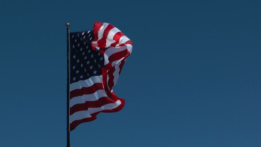 HD of American flag blowing in the breeze on a beautiful day - HD stock footage clip