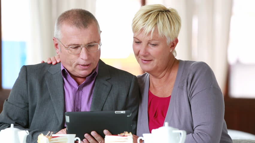 Senior couple having no trouble using a digital pad - HD stock video clip