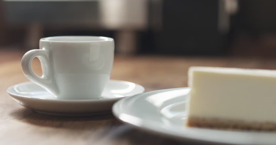 Pan shot of espresso and cheesecake on table | Shutterstock HD Video #28441645