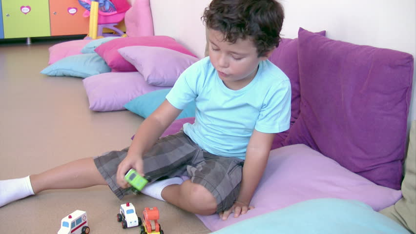 Preschool Student playing toy cars in the classroom - HD stock footage clip