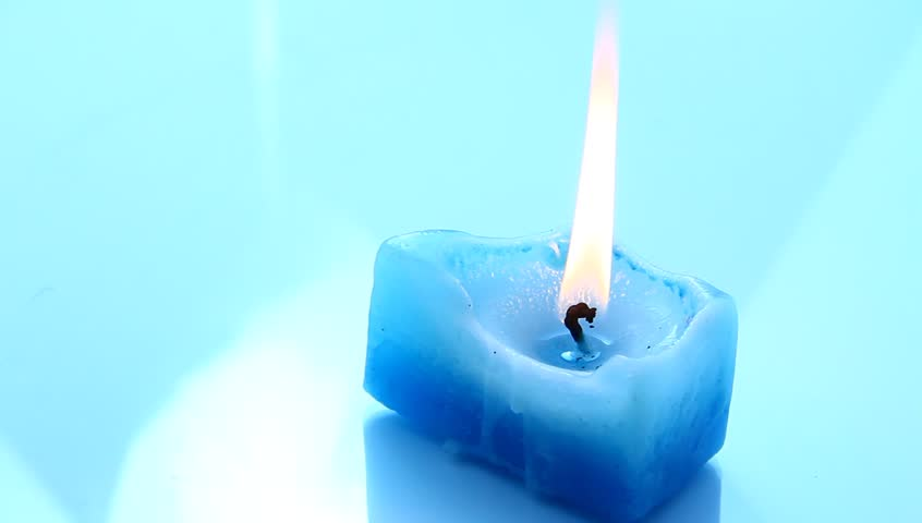 A light from blue candle. - HD stock footage clip