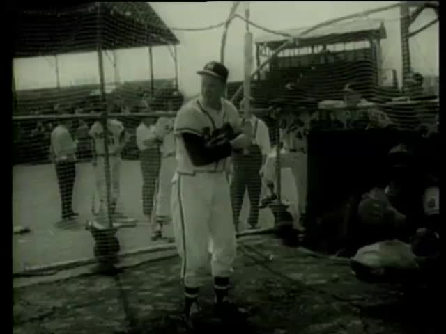 Milwaukee Braves baseball player infielder Red Schoendienst, warms up in Milwaukee County Stadium, Florida circa 1958-MGM PICTURES, UNIVERSAL-INTERNATIONAL NEWSREEL, USA, filmed in 1958 - SD stock footage clip