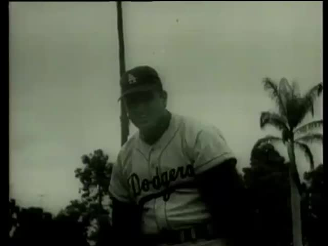 Dodgers baseball players practice pitching in Florida circa 1958-MGM PICTURES, UNIVERSAL-INTERNATIONAL NEWSREEL, USA, filmed in 1958 - SD stock footage clip