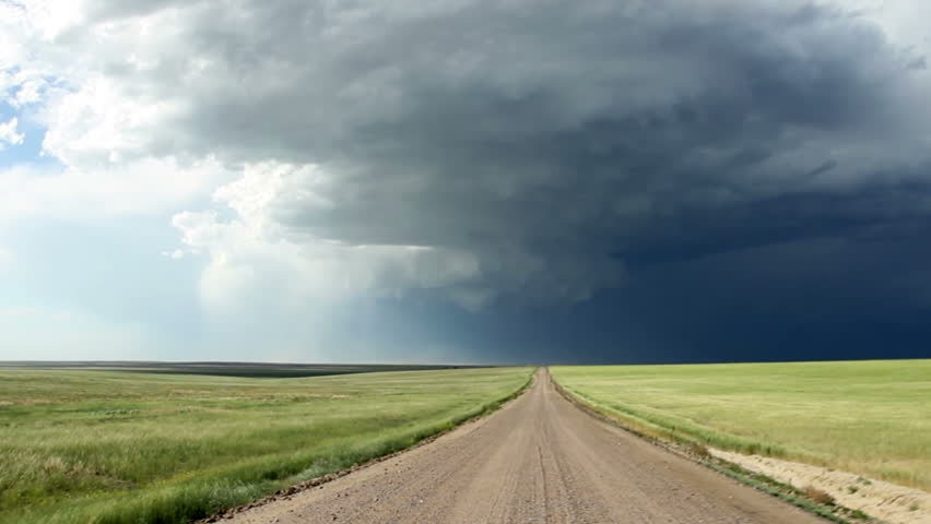Driving towards a supercell thunderstorm in eastern Colorado. HD 1080p vehicle