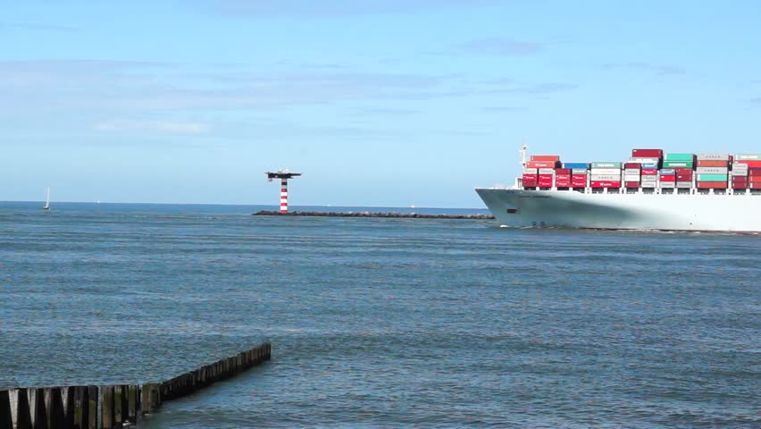 ROTTERDAM - AUGUST 2: Container Ship COSCO with full of cargo from the port of Rotterdamon on August 2, 2012. COSCO Group is the largest liner carrier in China. - HD stock footage clip