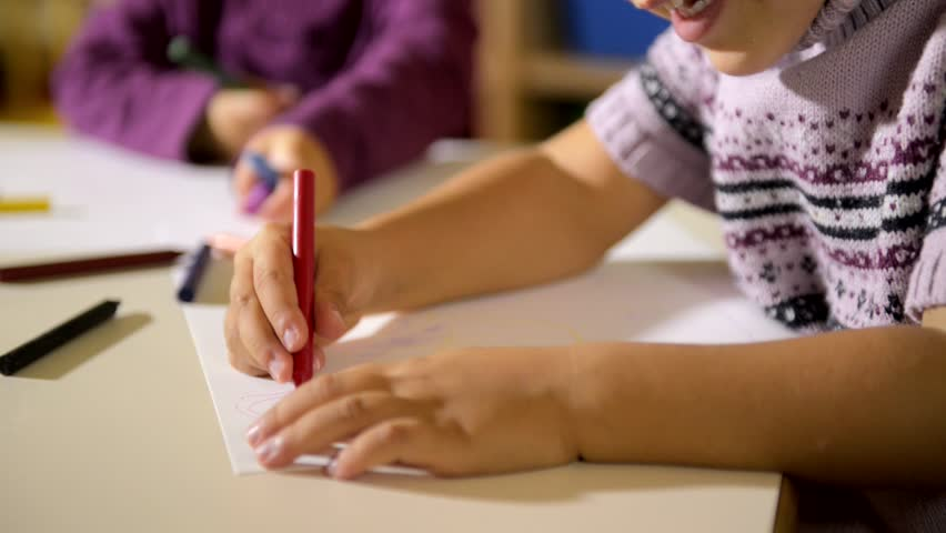 Two happy young girls drawing in kindergarten. Sequence | Shutterstock HD Video #2862268