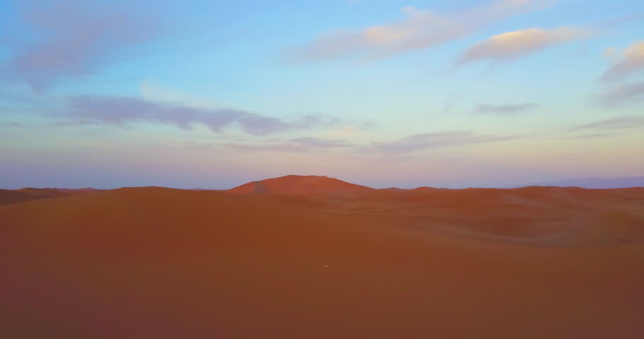Morocco-2010s: A remarkable aerial over desert sand dunes at sunrise in Morocco.   Shutterstock HD Video #28631311