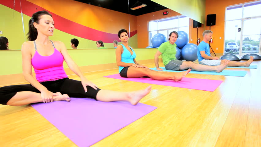 Multi ethnic health fitness group working out in body toning classes - HD stock video clip