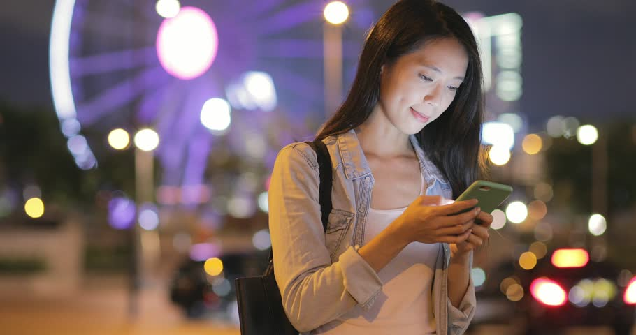 Woman working on smart phone in the city   Shutterstock HD Video #28725010