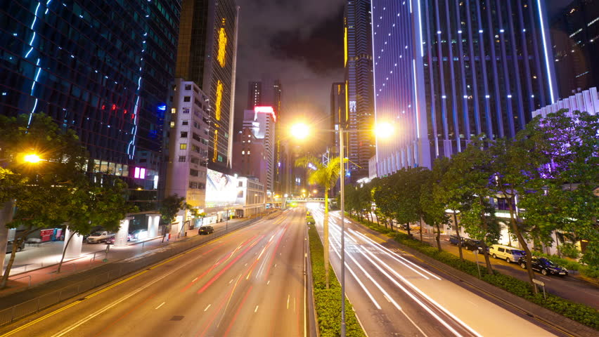 Street traffic in Hong Kong at night, hyperlapse - HD stock video clip