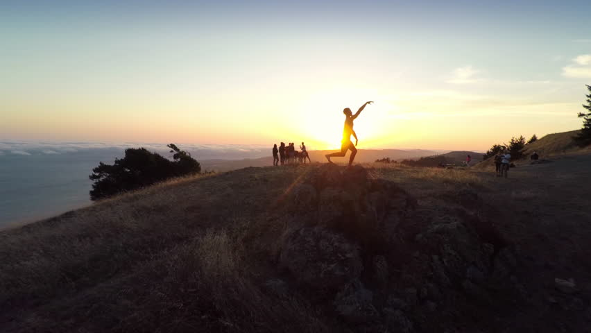 Aerial view of a ballet dancer dancing on a rock at sunset in San Francisco | Shutterstock HD Video #28807054