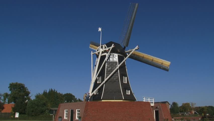 WINTERSWIJK, THE NETHERLANDS - Beltmolen-type windmill Bataaf (anno 1801) which stands on and in an artificial (brick)mound with large loading doors in the base. - HD stock video clip