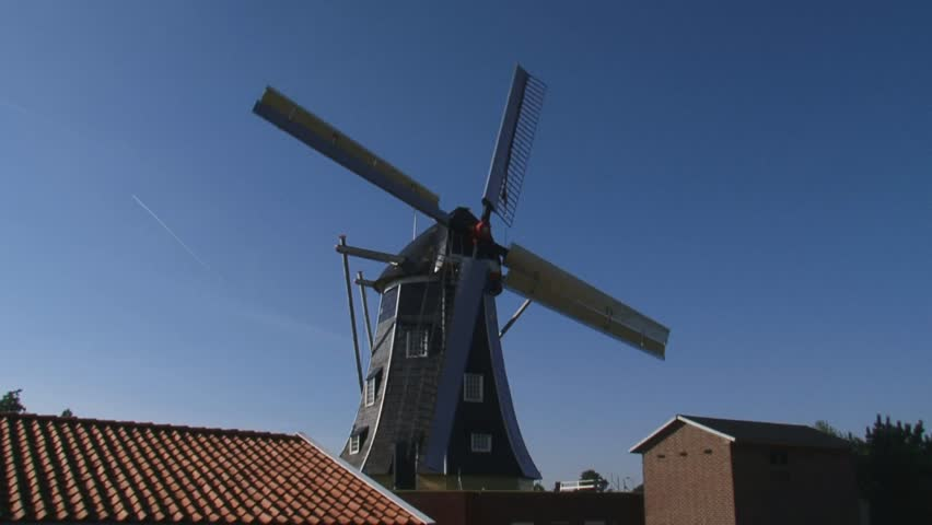 WINTERSWIJK, THE NETHERLANDS - windmill Bataaf (anno 1801) a Dutch Beltmolen which stands on and in an artificial mound. - HD stock video clip